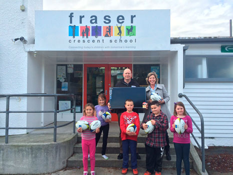 """Fraser Crescent School Principal John Channer was thrilled to receive a new 32"""" Panasonic TV and 27 rugby balls after he won the CrestClean competition at the New Zealand Principal's Federation Conference."""