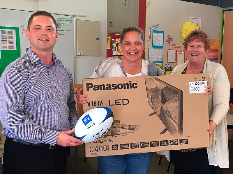 "CrestClean National Sales Manager Chris Barker presented Freemans Bay School Principal Sandra Jenkins and Machelle Whaea with a 32"" Panasonic TV and 9 LeslieRugby balls."
