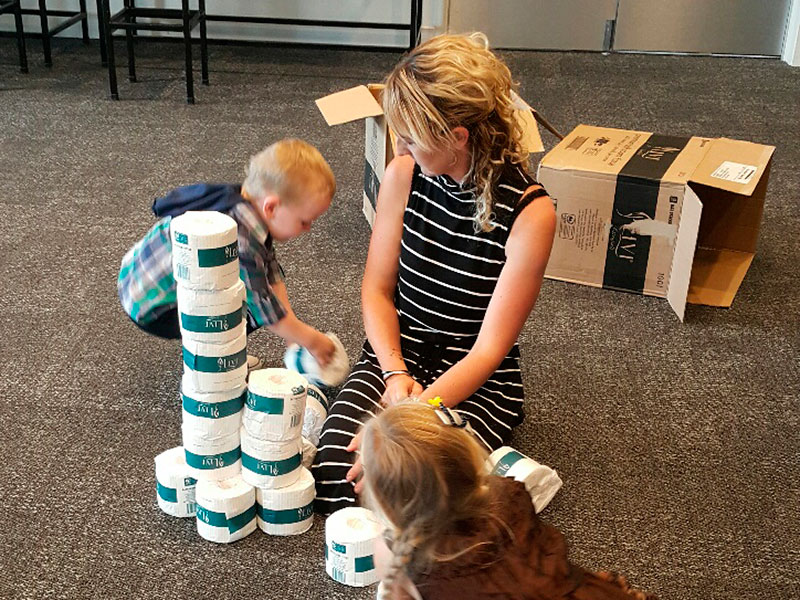 Noah and Kara Borgfeldt decided to make their own tower out of toilet paper with guidance from their mother, Heidi.