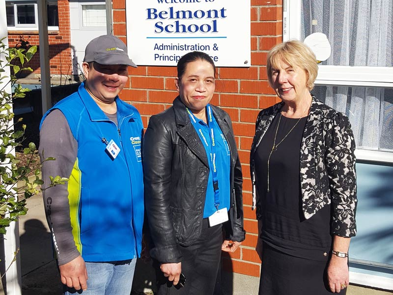 "Helen and Greg Caingcoy are ""part of the Belmont School team"". They are seen with Principal Robin Thomson."