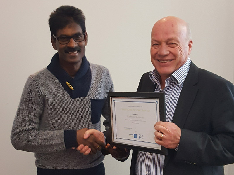 Keshwan's a man on a mission to reach 10 years with CrestClean. He is seen receiving his seven-year Long Service Certificate from Wellington Regional Manager Richard Brodie.
