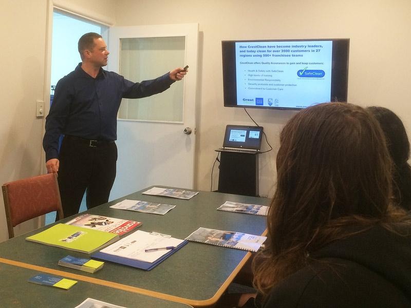 Chris Barker explains the franchisee system to attendees at the seminar.