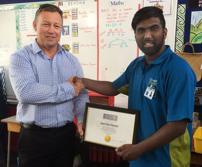 Ashitosh Prasad receives his Certificate in Commercial Cleaning Level 1 from Crest's South Canterbury Crest Regional Manager Rob Glenie.