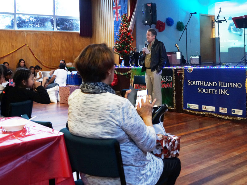 Glenn Cockroft addresses the gathering at the end-of-year function for the Southland Filipino Society.