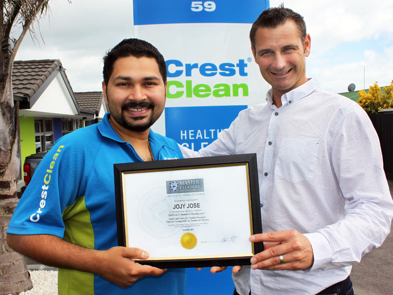 Jojy Jose receives his Certificate in Commercial Cleaning Level 1 from Jan Lichtwark.