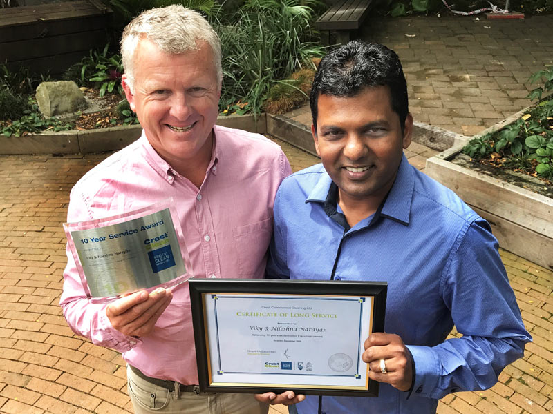 Viky Narayan receives his Long Service Award from Grant McLauchlan.