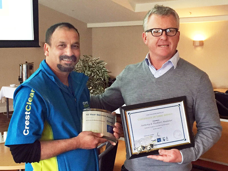 Anthony Mudaliar receives his 10-year Long Service Award from CrestClean Managing Director Grant McLauchlan.
