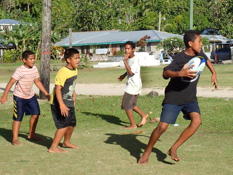 Island kids enjoying the gift of a Leslie Rugby ball.