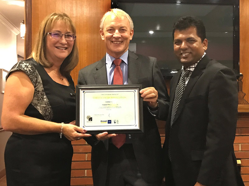 Leyette Callister receives the award from Auckland Mayor Phil Goff. Looking on is Viky Narayan, Crest's South and East Auckland Regional Manager.