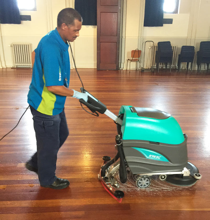 Franchisee Hary Ficks using a brand new automatic scrubber.