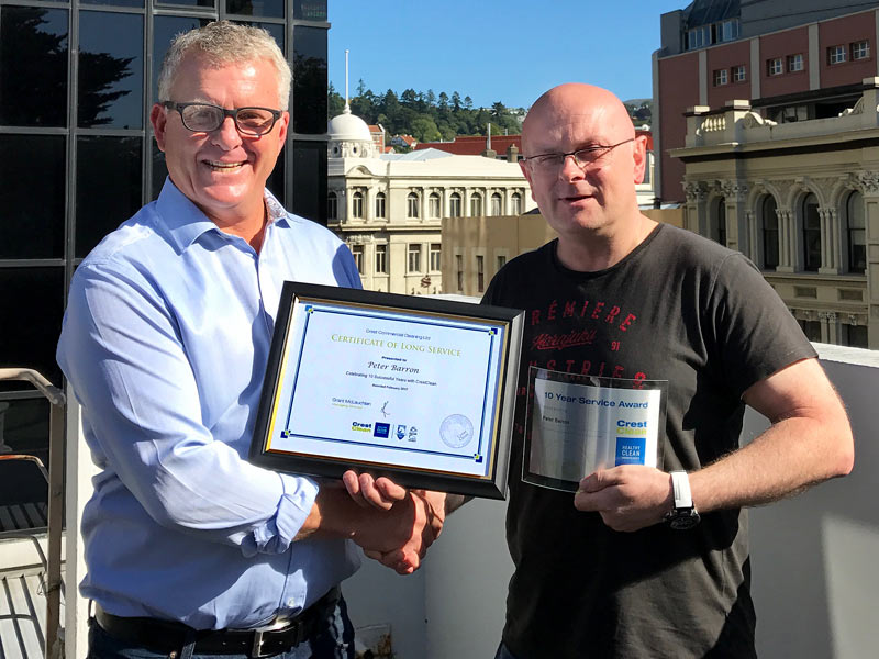 Peter Barron receives his 10-year Long Service Award from Grant McLauchlan, CrestClean Managing Director.