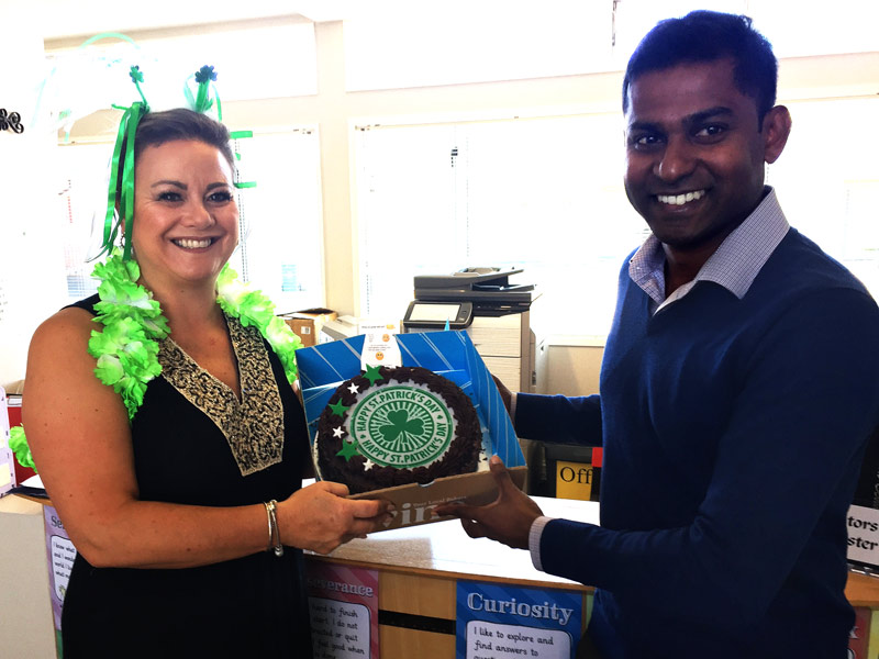 Angela Stuart, School Secretary at St Patrick's School, Kaiapoi, with the surprise cake delivered by Yasa Panagoda.