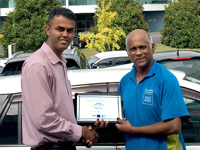 Ashveen Raju receives his Certificate of Long Service Award from Neil Kumar, CrestClean's North Harbour Regional Manager.