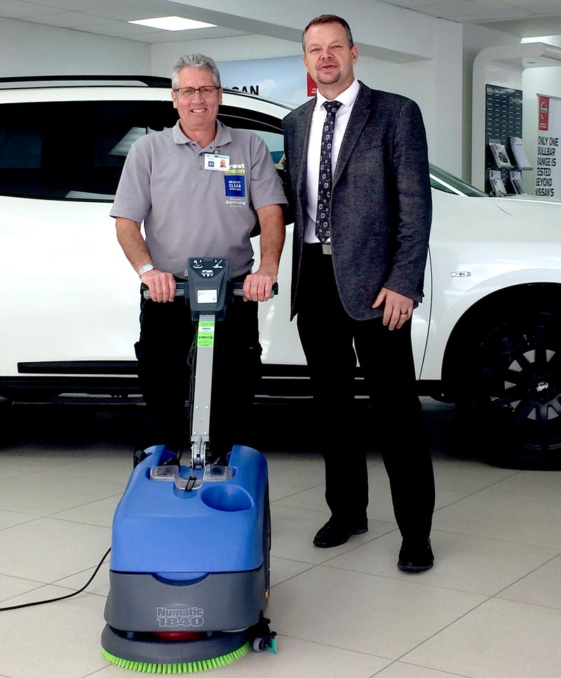 CrestClean franchisee Murray Kelly demonstrates the floor scrubber to Chris Churchward, Dealer Principal, Autoworld Timaru.