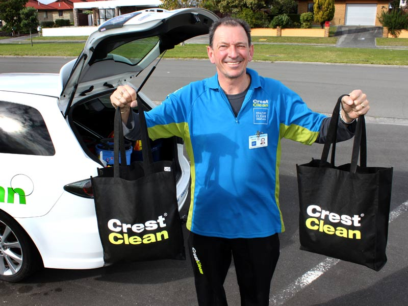 Tauranga franchisee Malcolm Brown helps road test the new CrestClean bags.