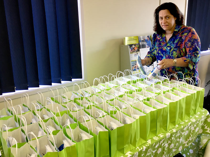 Barbara de Vries puts together the gifts for delegates attending the lunch.