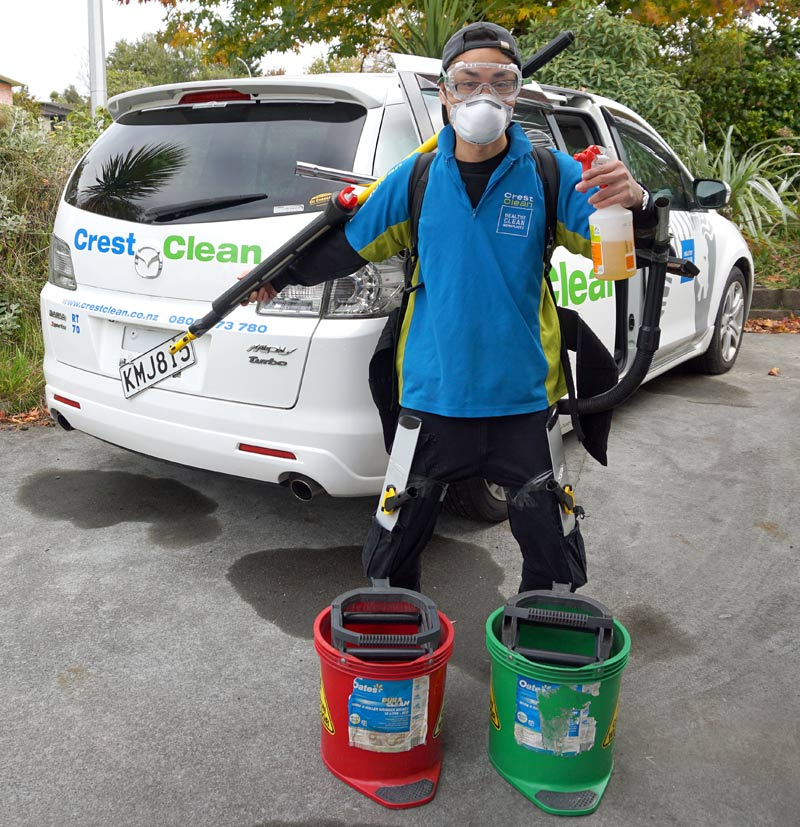 """William Lin, from Rotorua, dressed up with his gear as a """"working robot""""."""