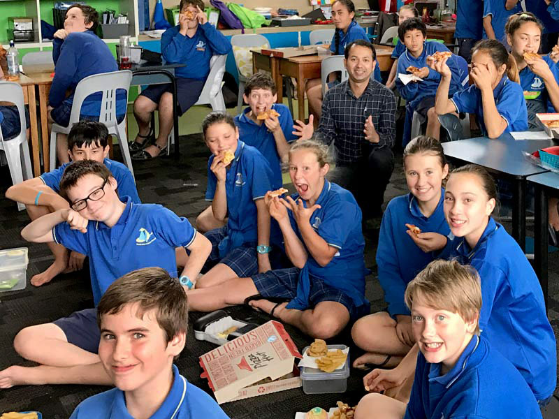 Prasun Acharya was thrilled to deliver pizza to students at Devon Intermediate School, New Plymouth, as a reward for keeping their classroom clean and tidy.