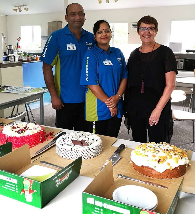 Ashwin and Rownel Chandra with Auckland West Regional Manager Caroline Wedding with the cakes for school staff.