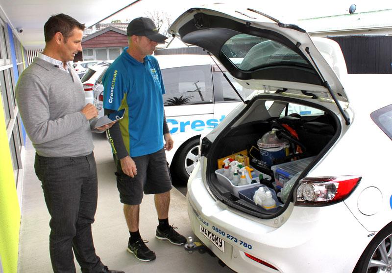 CrestClean's Tauranga Regional Manager Jan Lichtwark checks over Craig Stevens' car.