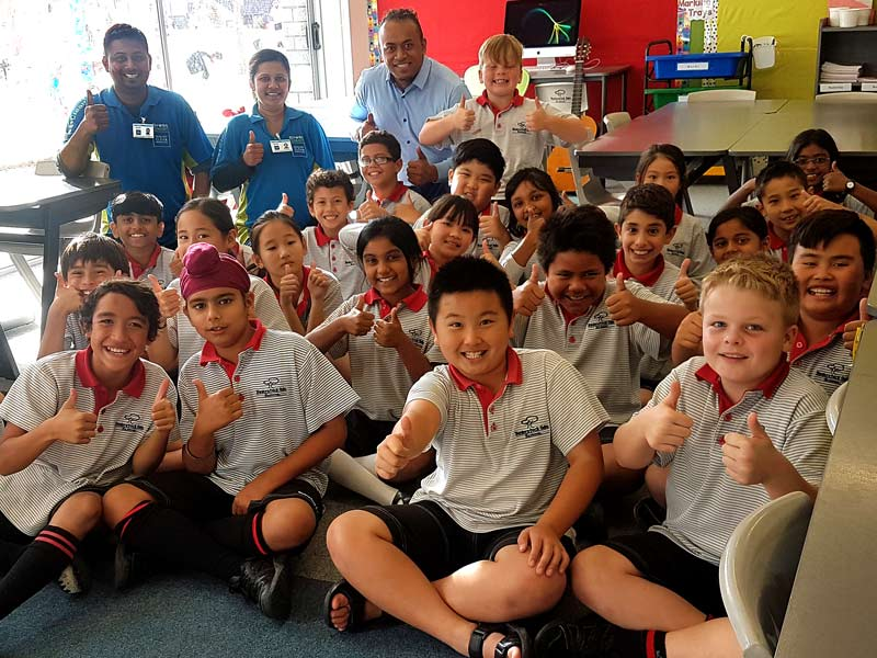 Shiva and Shartika Naicker are treated to a song by Baverstock Oaks School kids and their teacher Robert Tuli.