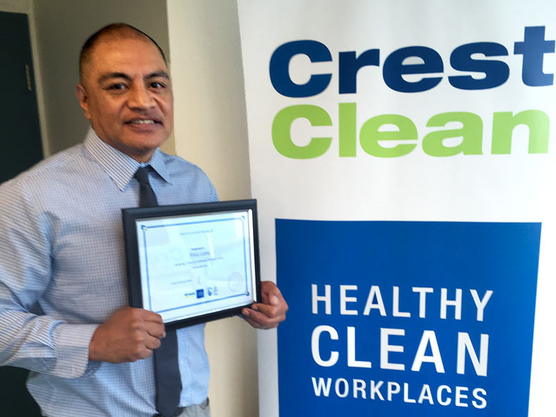 Fiva Latu with his Certificate of Long Service.