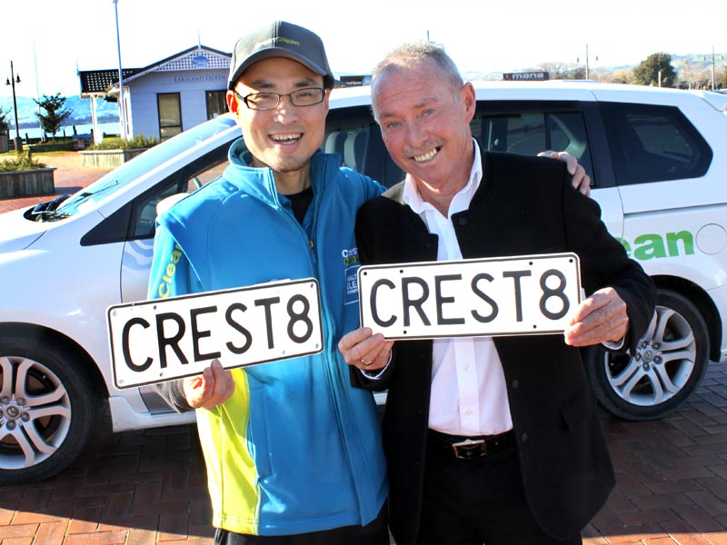Regional Manager Bill Douglas presents William Lin with his prize number plate.