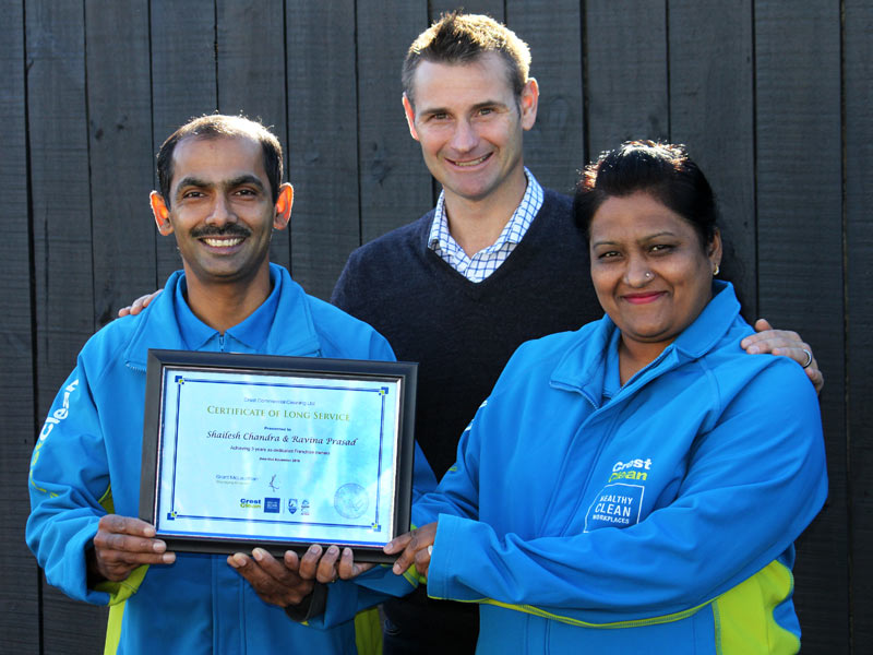 Shailesh Chandra and Ravina Prasad receive their Certificate of Long Service from Jan Lichtwark, CrestClean's Tauranga Regional Manager.