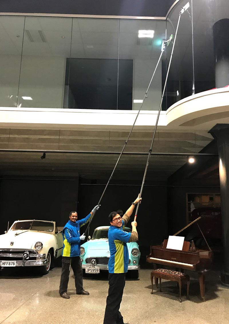 Franchisee's Martyn De Guzman and Harry Ficks at work on the windows at Invercargill's Bill Richardson Transport World.