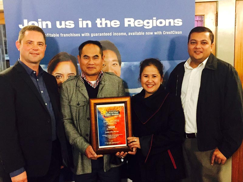 Fredie and Niza Dela Cruz with their award. Looking on are Chris Barker, National Sales and Relocation Manager, CrestClean, and Nivitesh Kumar, CrestClean's Waikato Regional Manager.