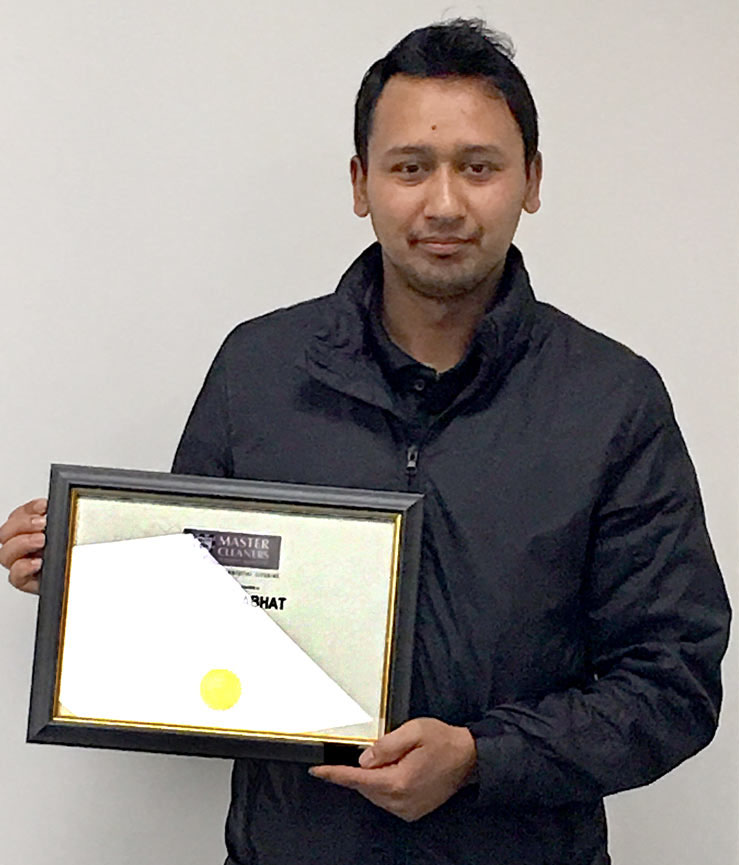Jivan Ranabhat with his Master Cleaners certificate.