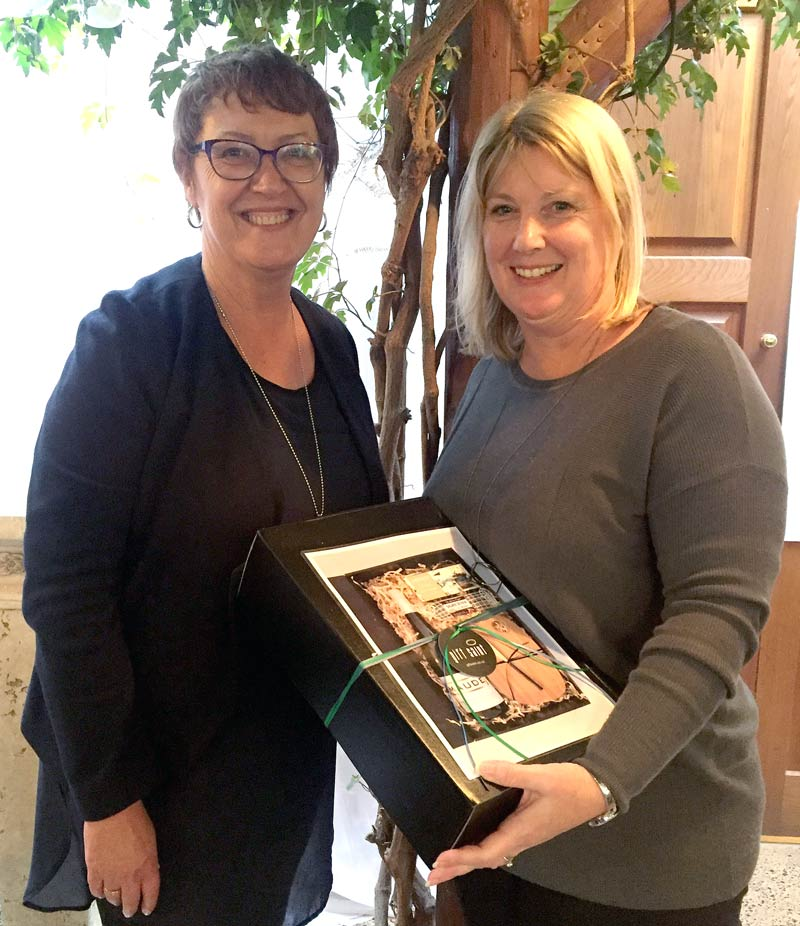 Ngaire Williams, from Glen Eden Primary School, receives a gift hamper from Caroline Wedding, CrestClean's Auckland West Regional Manager. The prize was for winning a competition draw.