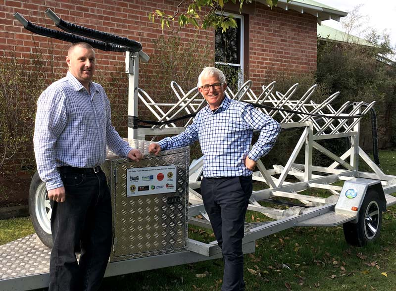 James Dixon with Clyde School Principal Doug White and the new bike trailer.