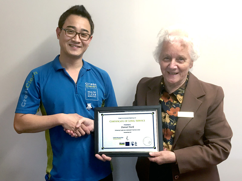 Daniel Park receives his Certificate of Long Service from Carol Abley, Principal Stanmore Bay School.