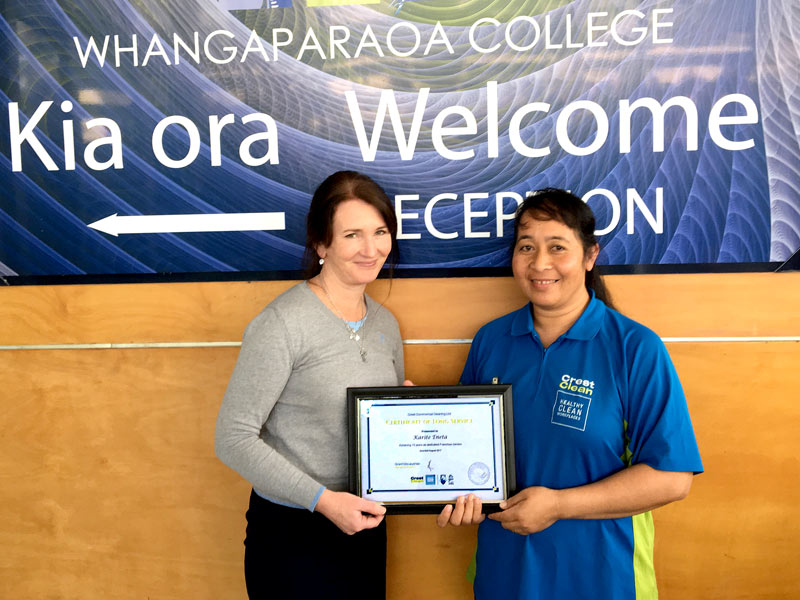 Karite Eneta receives her Certificate of Long Service from Ginny Catterall at Whangaparaoa College.