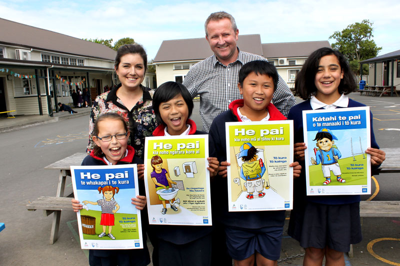 Sacred Heart School Principal Frank McManus with Gina Holland, CrestClean's Christchurch South Regional Manager, and pupils Rachael, Sean, Angelo and Te Haeata.
