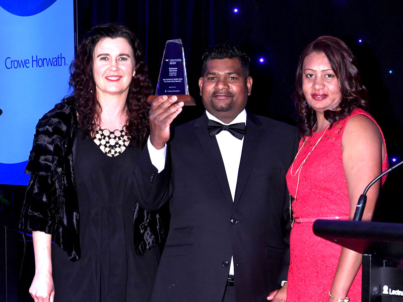 Dan Pariachi and Madhu Mala receive their Award from Michelle Malcolm of Crowe Horwath (left).