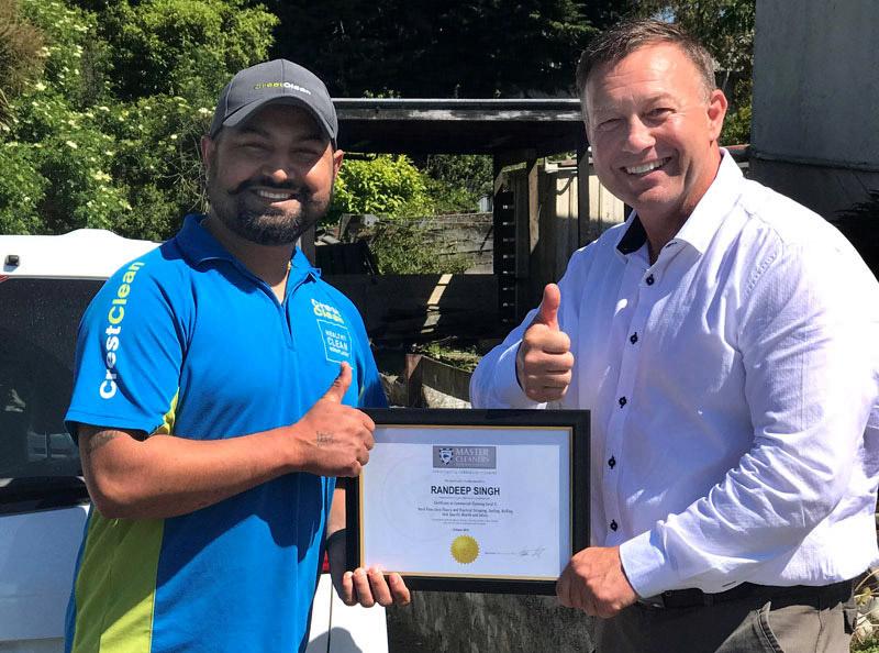 Randeep Singh receives his training award from Robert Glenie.