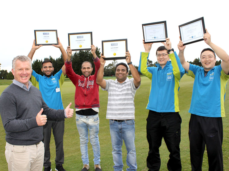 Crest Clean Managing Director Grant McLauchlan handed out training awards at a team meeting in 2017. Pictured are: Rajesh Rajesh, Yogesh Patel, Alex Varghese, Wei (Leo) Li, Guang (Sunny) Yang