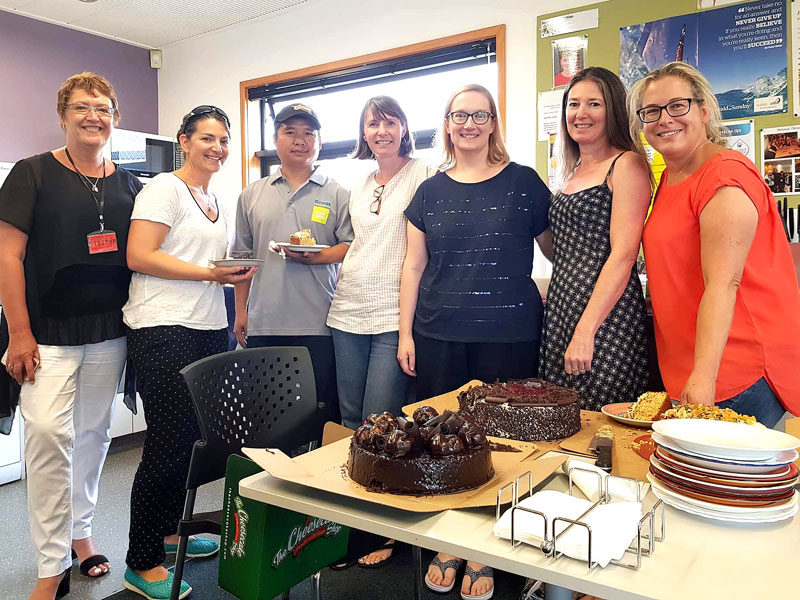 CrestClean's Caroline Wedding (left) puts on a morning tea. With her is caretaker Thang Hlawnceu and Windy Ridge School staff Sarah Turner, Brenda McPherson, Amanda Hurley, Jane Brown and Caroline Walker