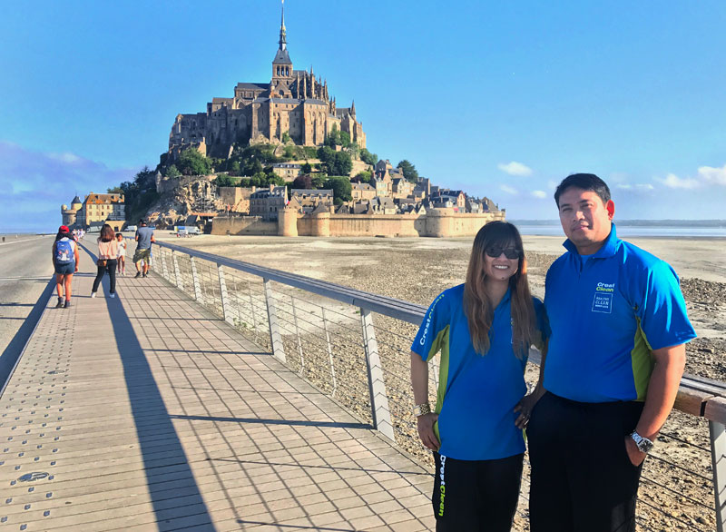 Jackie and Antony Batoy have a snap taken of themselves at Mont Saint-Michel, France.