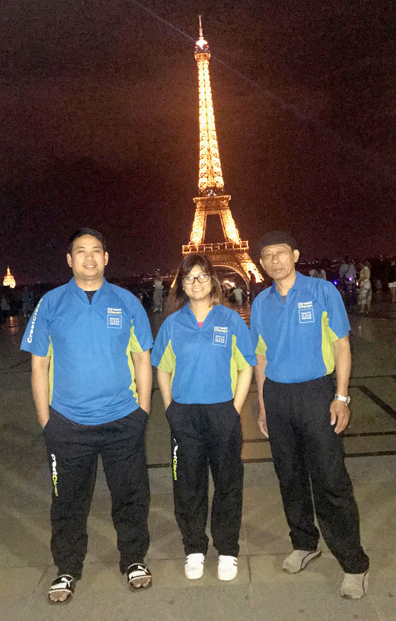 Jackie and Anthony Batoy with her father Jimmy pose at the Eiffel Tower in Paris.