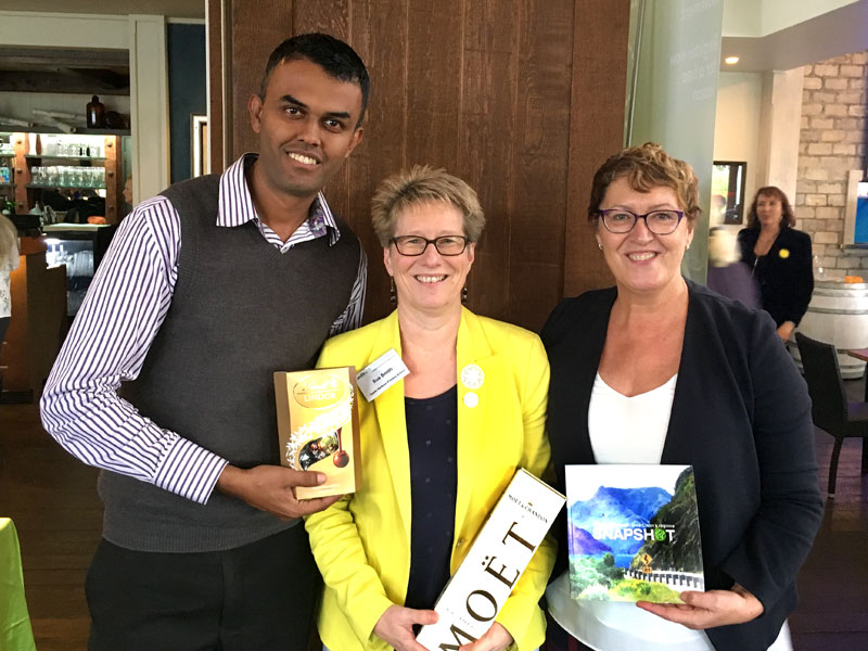 Bubbles and chocolates for Sue Smith. She is seen with CrestClean's Neil Kumar and Caroline Wedding.