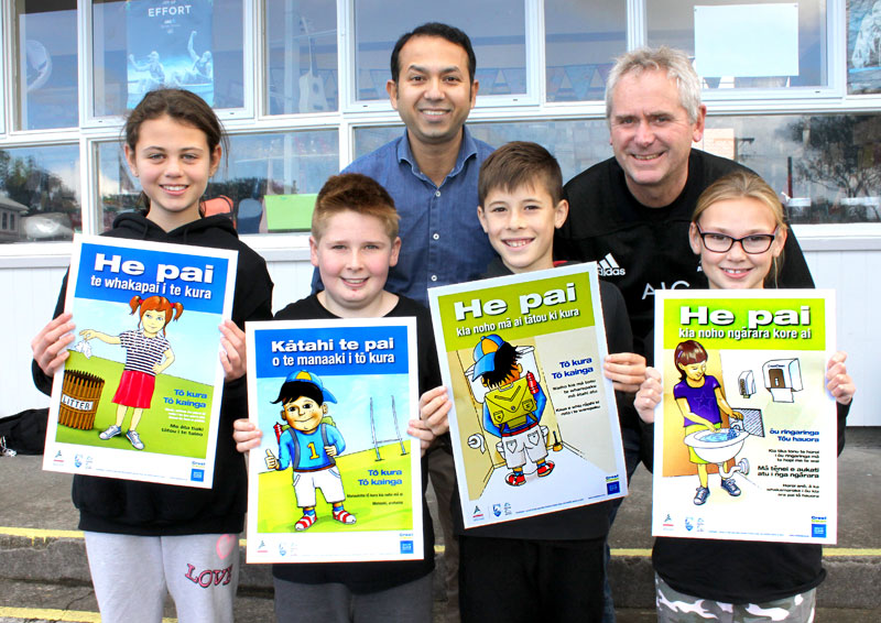 Prasun Acharya (centre), CrestClean's Taranaki Regional Manager, presents Maori posters to Vogeltown School Deputy Principal Mike George. With them are Room 8 pupils Kirra Jones, Dylan Richards-Beehre, Jacob Ansell and Rylee Schofield.