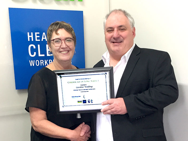 Caroline Wedding receives her award from Dries Mangnus, Auckland Central Regional Manager.