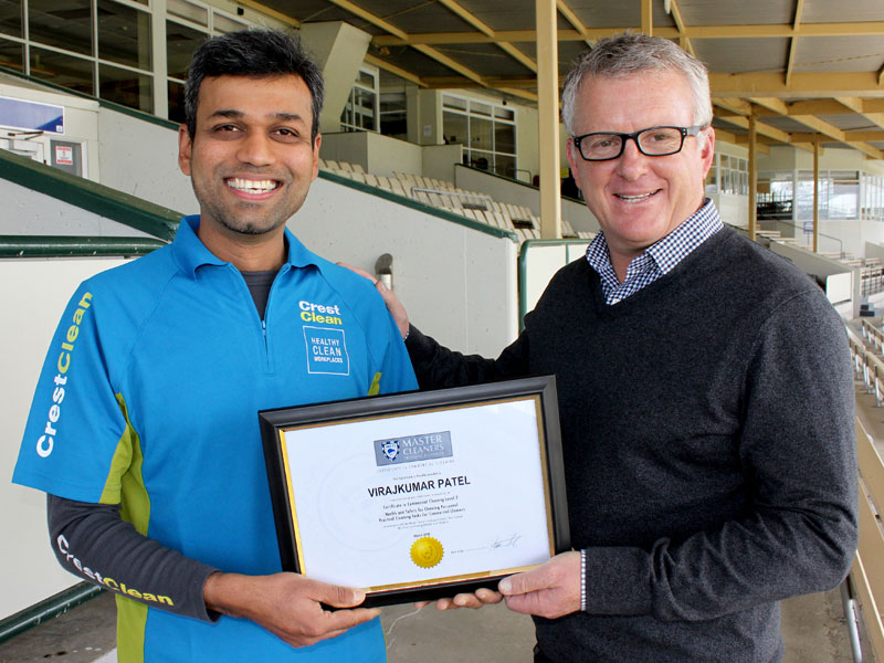 Virajkumar Patel receives a Certificate in Commercial Cleaning, Level 1, from Grant McLauchlan.