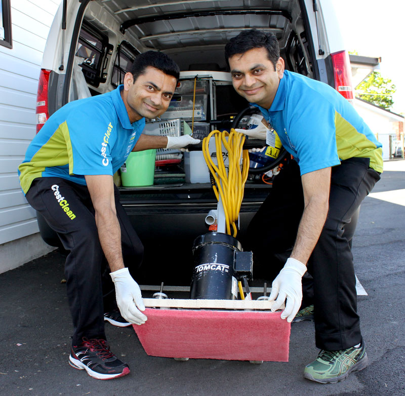 Pinakin and his brother Hitesh unload the The TomCat floor scrubber.