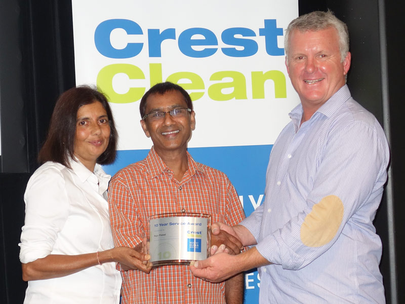 Rajju and Manorama Prasad receive their 10-year Long Service Award from Grant McLauchlan, CrestClean Managing Director.