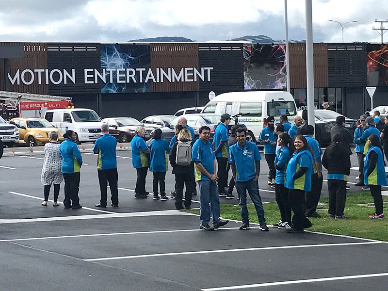 CrestClean's Rotorua personnel outside Motion Entertainment after evacuating the building when the fire alarm went off.