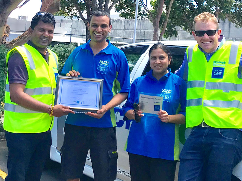 Viky Narayan, CrestClean's Regional Manager for South and East Auckland, presents the Long Service Award to Shalend and Kamni Ram. Looking on is Sam Lewis, General Manager Franchise Services.